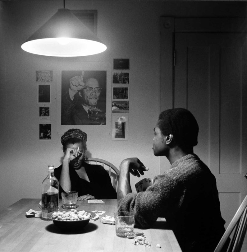 Carrie Mae Weems, Untitled (Playing Cards/Malcolm X) from the Kitchen Table II series, 1990, printed 1999, gelatin silver print, edition 2/5, 26 ¾ × 26 ⅞ inches. Museum purchase with funds provided by 2004 Collectors' Circle, 2004.24.04.91. © Carrie Mae Weems.