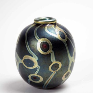 Mark Peiser, Miniature Vase from the Spots series, 1974, silver luster, murrini, iridizations, and hot-tooled applications on glass, 3 ⅝ × 3 × 3 inches. Gift of Martha Jane Peiser, 2005.08.01.50. © Mark Peiser