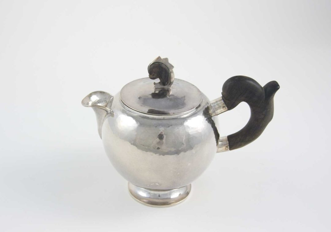 William Waldo Dodge Jr. and Johnny Green, Teapot, circa 1928, hammered silver and ebony wood, 8 × 5 ¾ × 9 ½ inches . Gift of William Waldo Dodge III, 2005.26.03.59. © Estate of William Waldo Dodge Jr.