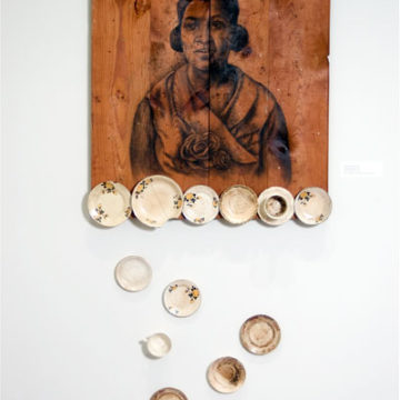 Whitfield Lovell, One of These Days, 2006, charcoal and china on wood, 84 × 37 × 4 ½ inches. Museum purchase with funds provided by 2007 Collectors' Circle with additional funds provided by Phillip Broughton & David Smith, 2007.33.01.29. © Whitfield Lovell