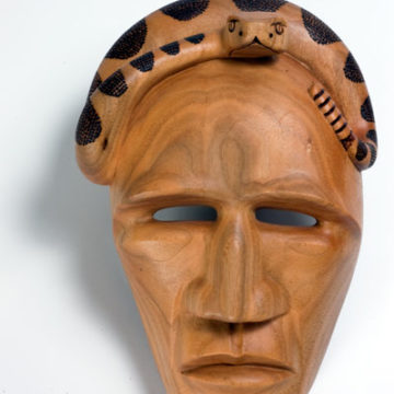 Virgil Crowe, Rattlesnake Mask, 2009, wood, 10 ¼ × 7 × 3 ⅝ inches. Museum purchase with funds provided by 2009 Art Nouveaux, 2010.01.03.54. © Virgil Crowe