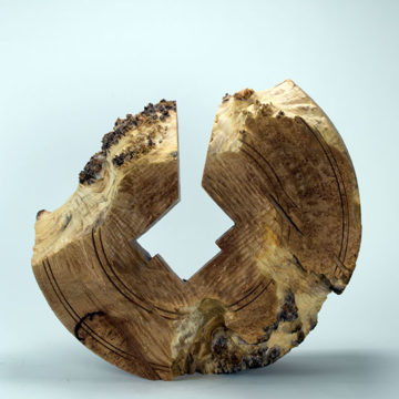 Robyn Horn, Fracture Millstone, 2000, turned and carved maple burl, 16 × 17 ¼ × 6 ¾ inches. Gift of Robyn & John Horn, 2011.19.31.32. © Robyn Horn