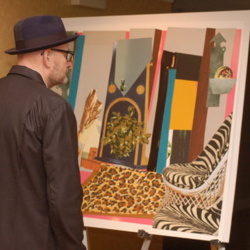 A collectors circle member views art.