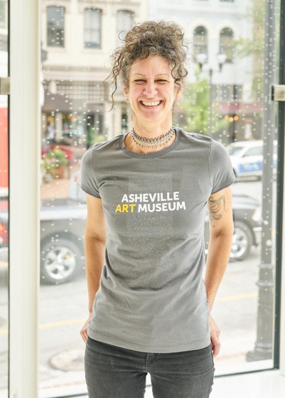 Woman modeling museum t-shirt