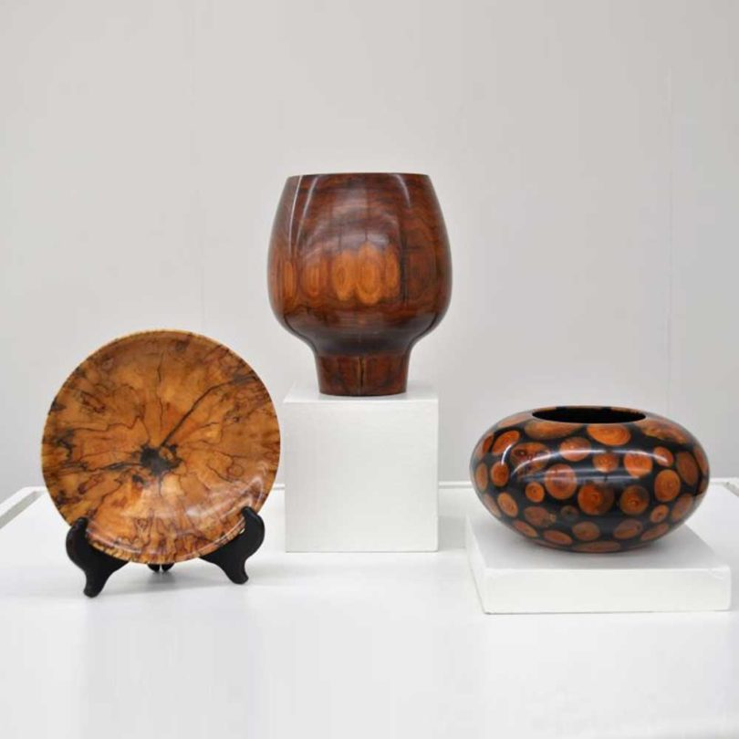Wood carvings featured in the exhibition.